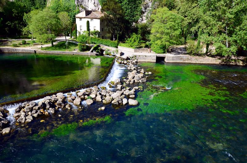 View on small touristic Provencal town with emerald green waters of Sorgue river. Provence in France. View on small touristic Provencal town with emerald green royalty free stock photos