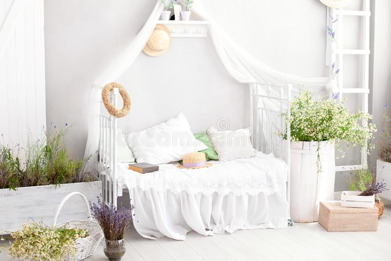 Provence, rustic style ,Lavender ! country white bedroom with wooden floor in retro style. Shabby chic interior girly in the Prove. Ncal style.  Village stock photo