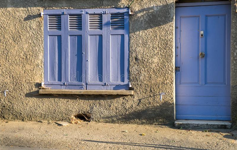 Provence style blue wooden doors and window shutters. France royalty free stock images