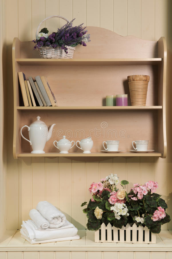 Provence style decorations on the wall. Provence style decorations. Fragment of interior design in Provence style decorated with shelves and books, elegant tea royalty free stock images