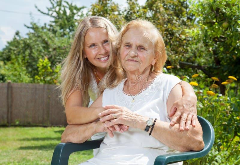Providing care for elderly royalty free stock photo