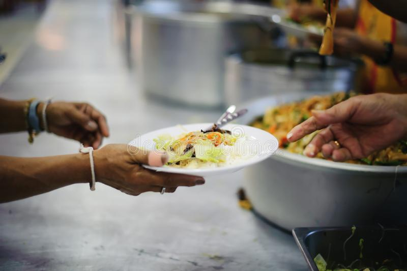 Providing food to the poor is helping sharing from fellow humans together : Concept of famine and social inequality royalty free stock images