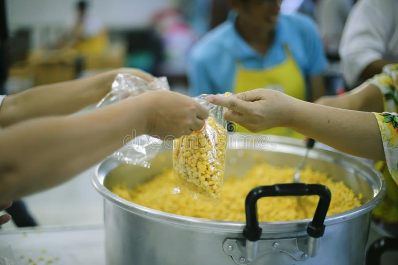Providing food to the poor is helping sharing from fellow humans together : Concept of famine and social inequality stock photo