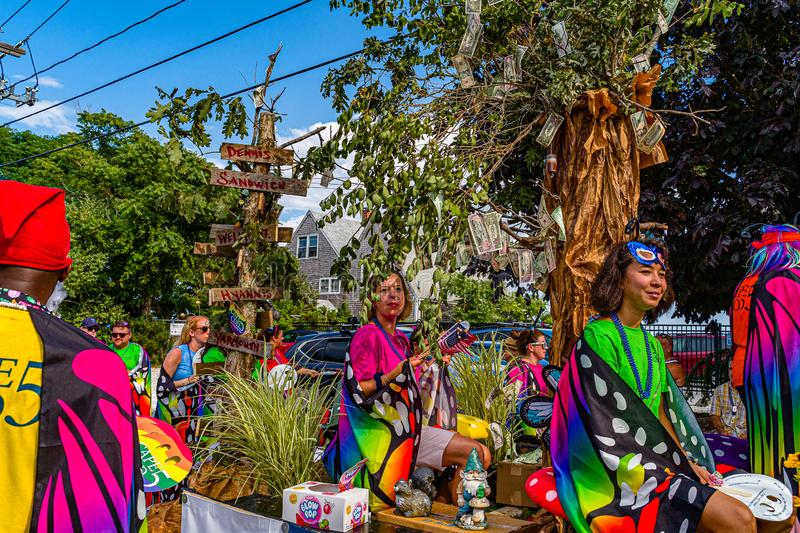 Provincetown, Massachusetts US - August 22, 2019 People walking in the Annual Provincetown Carnival Parade on Commercial Street. Provincetown, Massachusetts US royalty free stock photography