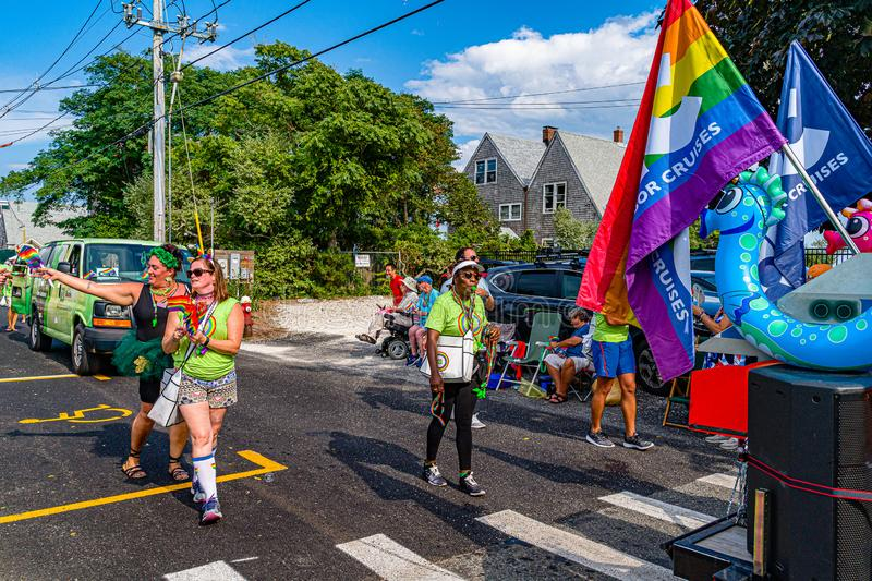 Provincetown, Massachusetts US - August 22, 2019 People walking in the Annual Provincetown Carnival Parade on Commercial Street. Provincetown, Massachusetts US royalty free stock image