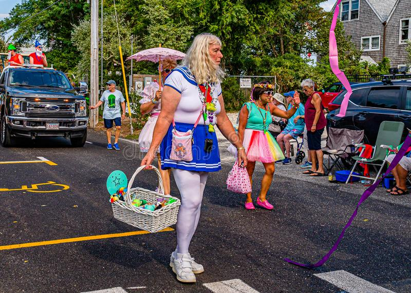 Provincetown, Massachusetts US - August 22, 2019 People walking in the Annual Provincetown Carnival Parade on Commercial Street.  royalty free stock image