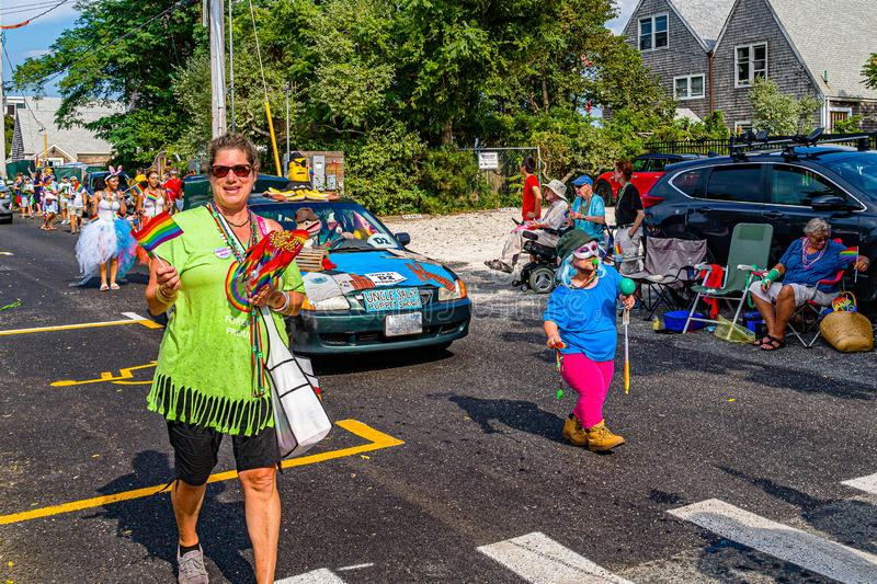Provincetown, Massachusetts US - August 22, 2019 People walking in the Annual Provincetown Carnival Parade on Commercial Street.  stock photography