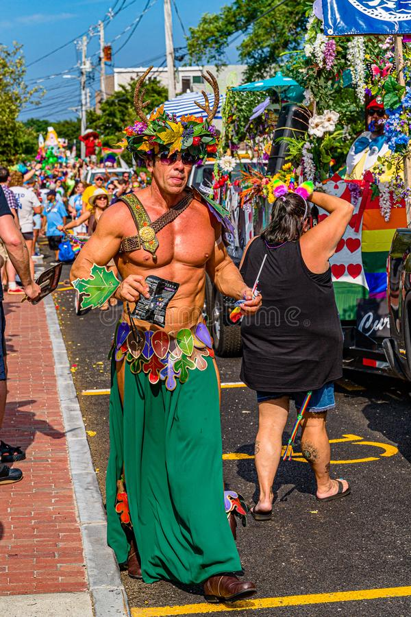 Provincetown, Massachusetts US - August 22, 2019 People walking in the Annual Provincetown Carnival Parade on Commercial Street.  royalty free stock photo
