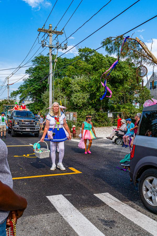 Provincetown, Massachusetts US - August 22, 2019 People walking in the Annual Provincetown Carnival Parade on Commercial Street. Provincetown, Massachusetts US stock photo