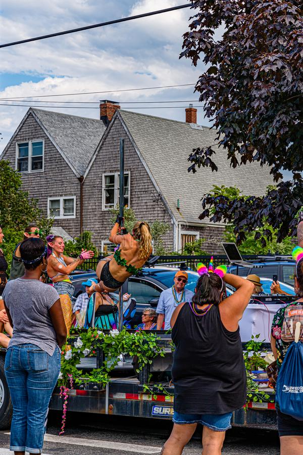 Provincetown, Massachusetts US - August 22, 2019 People walking in the Annual Provincetown Carnival Parade on Commercial Street. Provincetown, Massachusetts US stock images