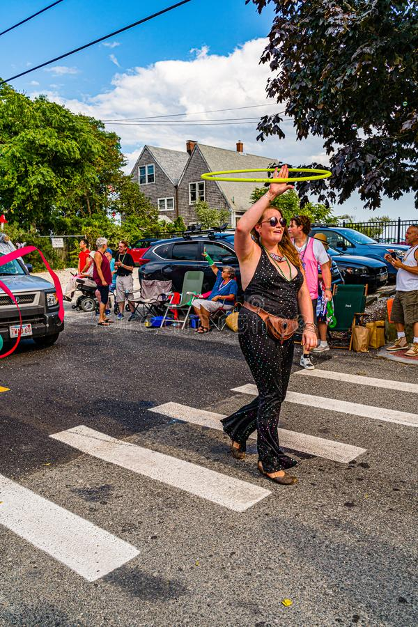 Provincetown, Massachusetts US - August 22, 2019 People walking in the Annual Provincetown Carnival Parade on Commercial Street. Provincetown, Massachusetts US royalty free stock photo