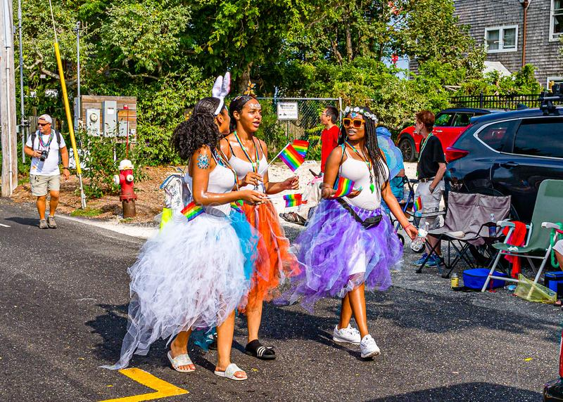 Provincetown, Massachusetts US - August 22, 2019 People walking in the Annual Provincetown Carnival Parade on Commercial Street. Provincetown, Massachusetts US stock photography