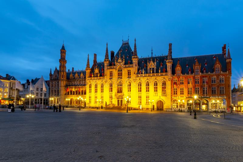 Provincial Court building on market square Grote markt at night, Bruges, Belgium royalty free stock images
