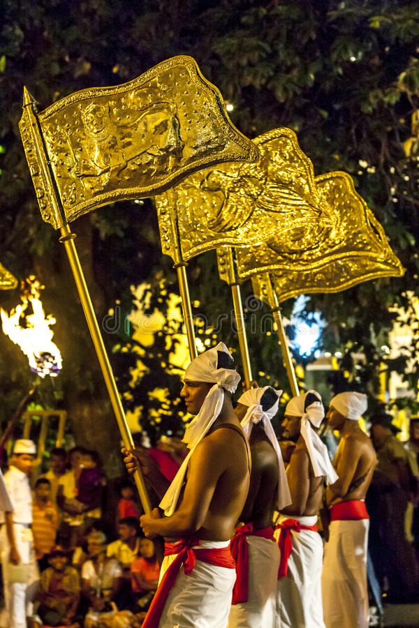 Provincial Flags being carried the streets of Kandy during the Esala Perahera in Sri Lanka. The Esala Perahera is held to honour the Sacred Tooth Relic of Lord stock photos