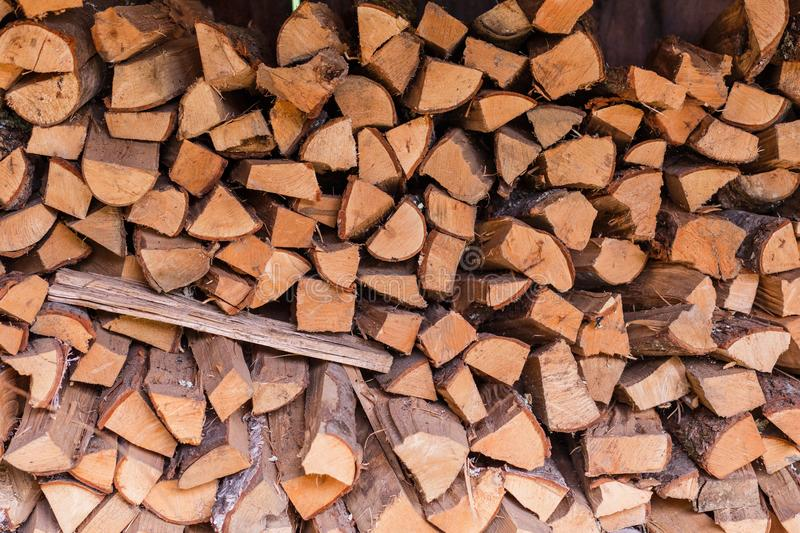 Stacked firewood. Provision of the stacked firewood stock images