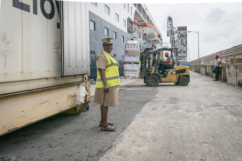 Provisions being Loaded onto Ship, Bridgetown, Barbados. BRIDGETOWN, BARBADOS, 21 DECEMBER 2015 - Port staff loadig provisions onto ship by fork lift truck at stock images