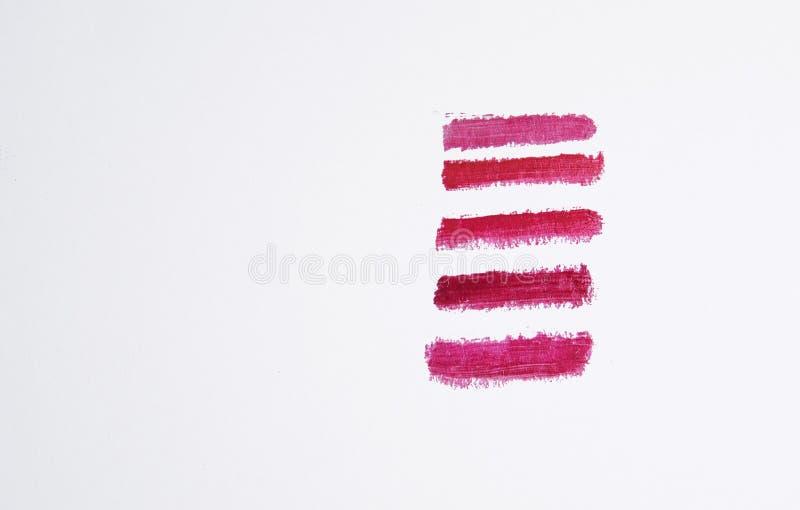 Provkartor av fem röda skuggor av läppstift royaltyfria bilder