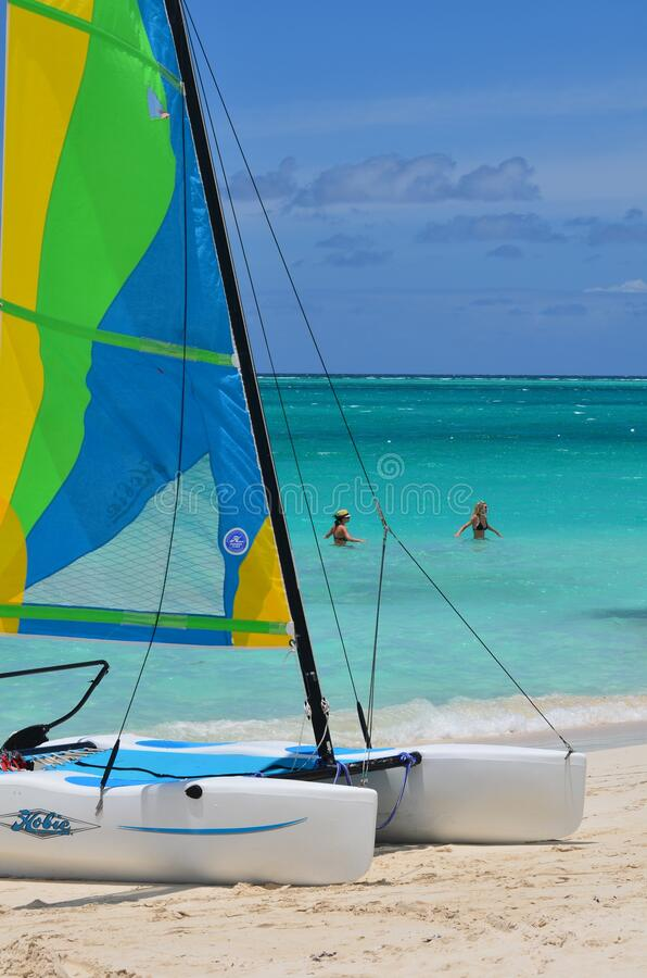 PROVO, UNITED STATES - Apr 01, 2020: Beautiful girls behind sailboat. PROVO, UNITED STATES - Apr 01, 2020: Sail boat in Caribbean.   Very colorful water of Turks stock images