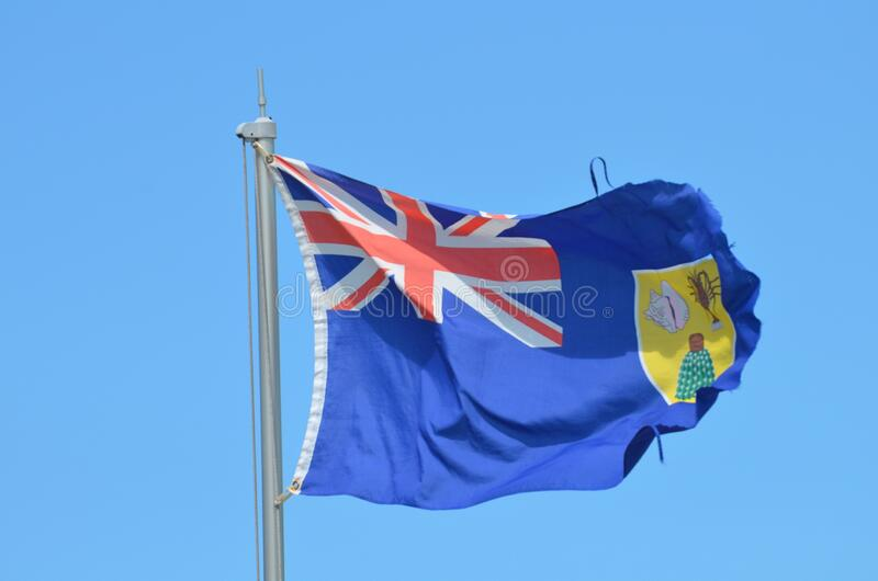 PROVO, UNITED STATES - Apr 01, 2020: Turks and Caicos Island flag. PROVO, UNITED STATES - Apr 01, 2020: Turks and Caicos flag blowing in the wind stock photo