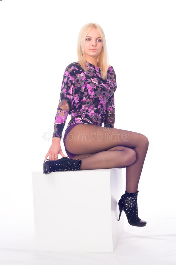 Provocative girl on a cube stock image
