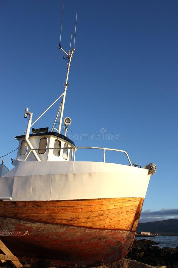 Prow agaist the Lofoten's sun. The prow of an old fishingboat against the last sun of November, Gravdal, Lofoten Islands royalty free stock photography