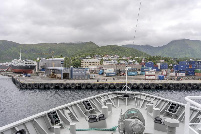 Prow of liner approaching harbor at Stokmarknes, Norway. STOKMARKNES NORWAY July 06 2019: harbor view, shot under bright cloudy light  on july 06, 2019 at stock image