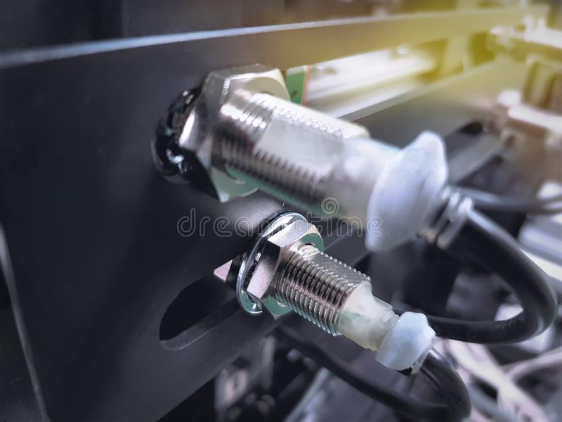 Proximity Sensor on Machine to Detect Moving Metal Parts. Engineering Scheme. Proximity Sensor on Machine to Detect Moving Metal Parts royalty free stock image