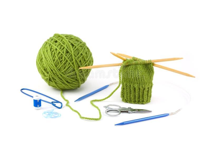 Proyecto y herramientas de la manopla del Knit foto de archivo