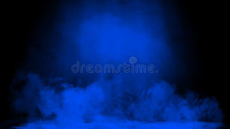 Proyector azul del estudio Etapa con humo en el fondo del piso Elemento del dise?o fotografía de archivo