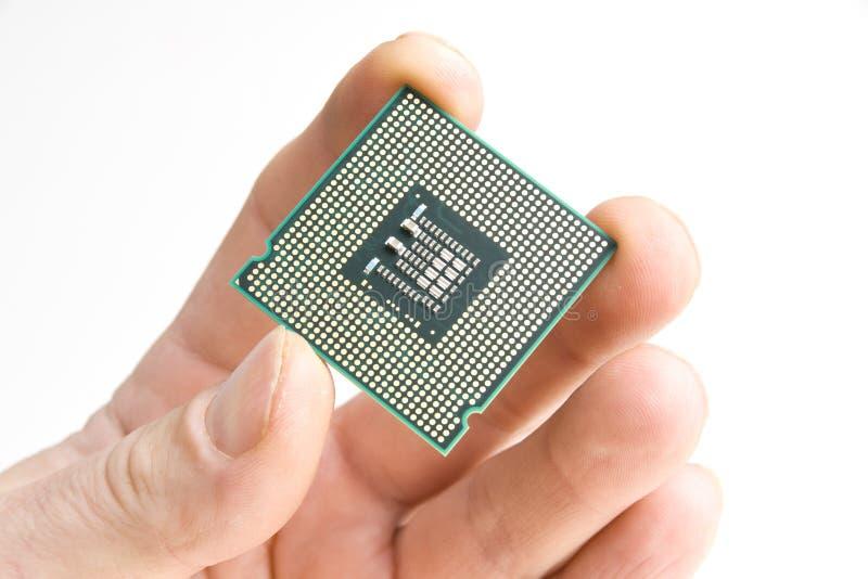 Prozessor in der Hand lizenzfreie stockbilder