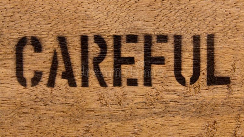 Prudent sur le bois images libres de droits