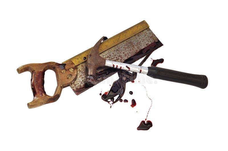 Pruners, scie et marteau sanglants sanglants image stock