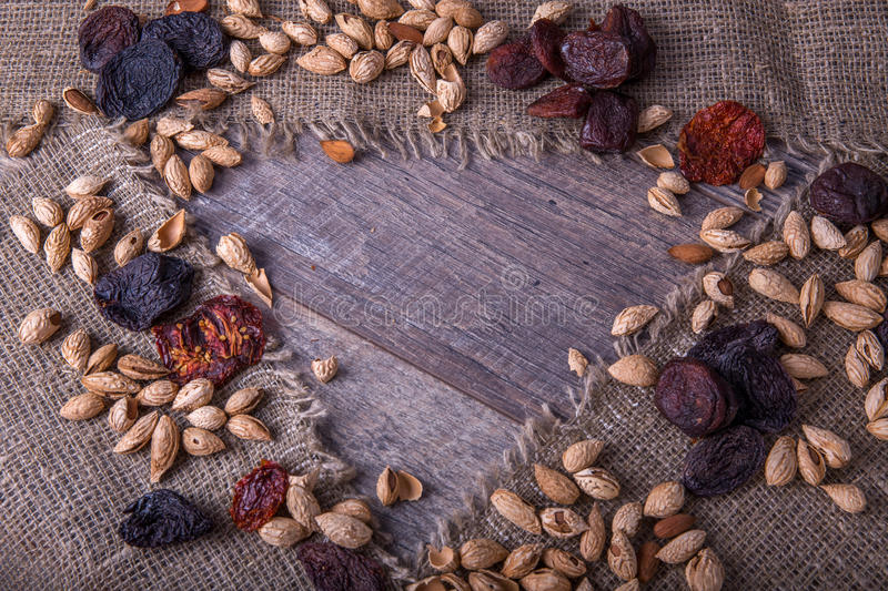 Prunes, dried apricots, raisins, almonds, dried tomatoes - handmade Bio products. Dried fruits, vegetables, nuts and stock photo