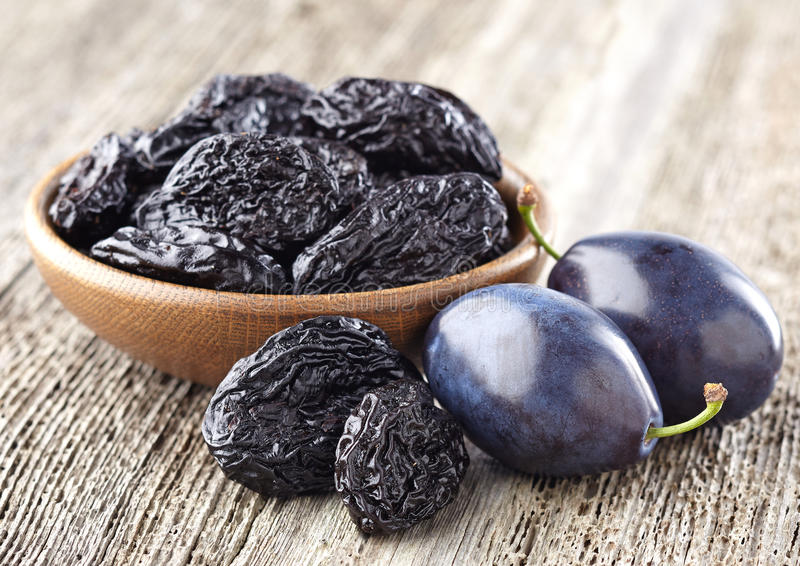 Prunes and plums stock images