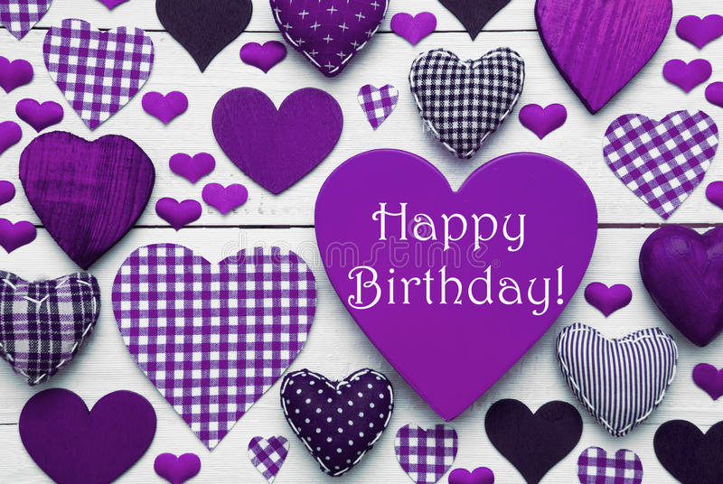 Pruple Heart Texture With Happy Birthday. Purple Heart Texture With English Text Happy Birthday. White Wooden Background. Textile Hearts Which Are Dotted and stock photos
