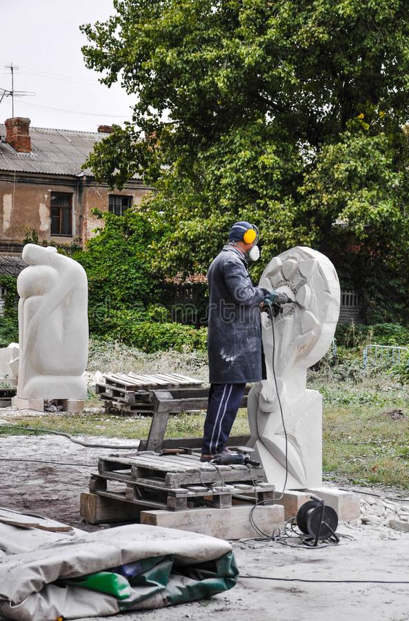 Pryluky, Ukraine - 09/14/2018: Sculpture Symposium, creation of. The monuments. Sculptors creating sculptures. For your design stock image