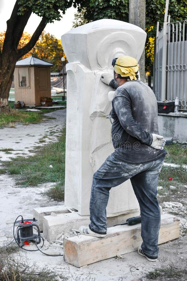 Pryluky, Ukraine - 09/14/2018: Sculpture Symposium, creation of. The monuments. Sculptors creating sculptures. For your design stock photo