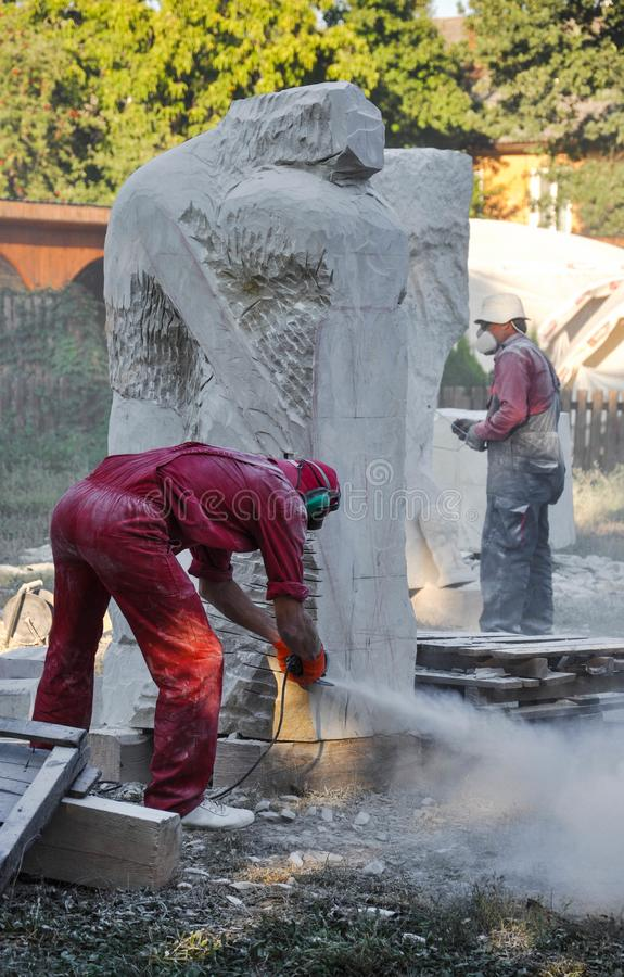 Pryluky, Ukraine - 09/14/2018: Sculpture Symposium, creation of. The monuments. Sculptors creating sculptures. For your design stock images