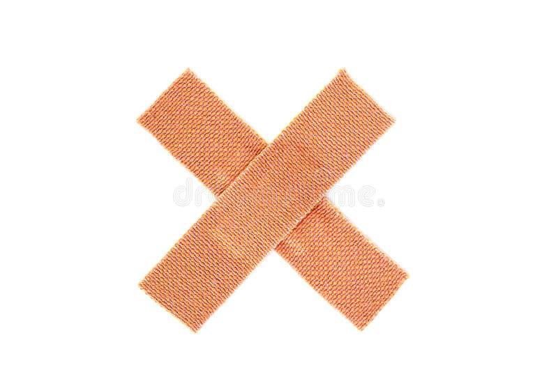 Przecinający bandaid zdjęcie stock