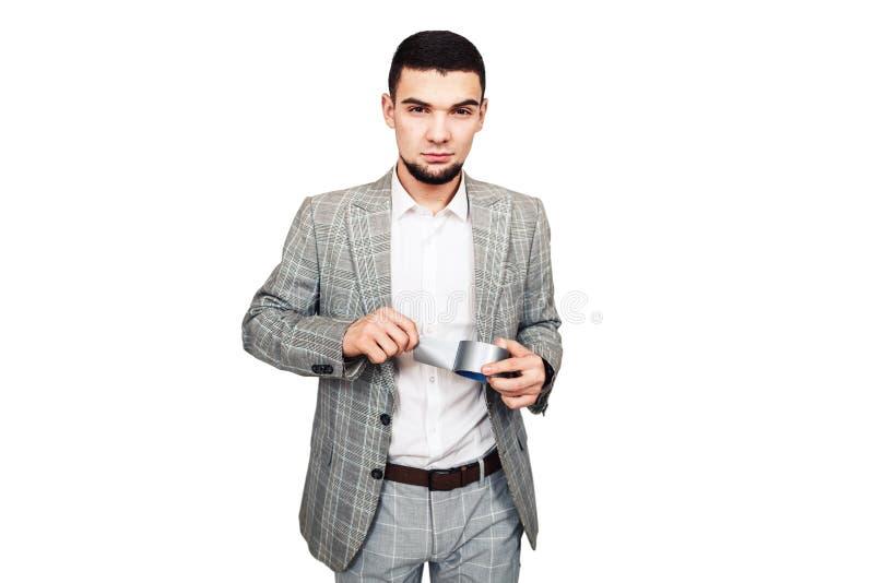 Przeciwnik wolność słowa, dyktator Elegancki młody brodaty facet w szarym kostiumu chce pieczętować twój usta z adhezyjną taśmą obrazy stock