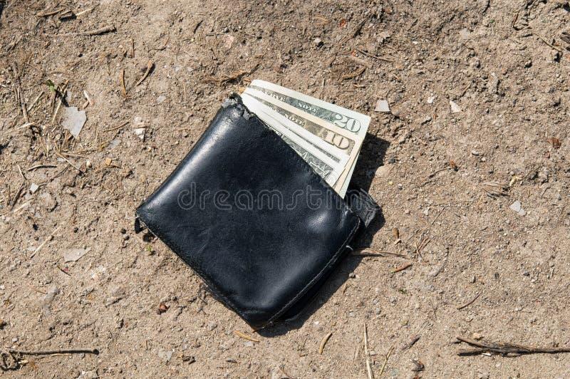 Przegrany portfel z pieniądze zdjęcia royalty free