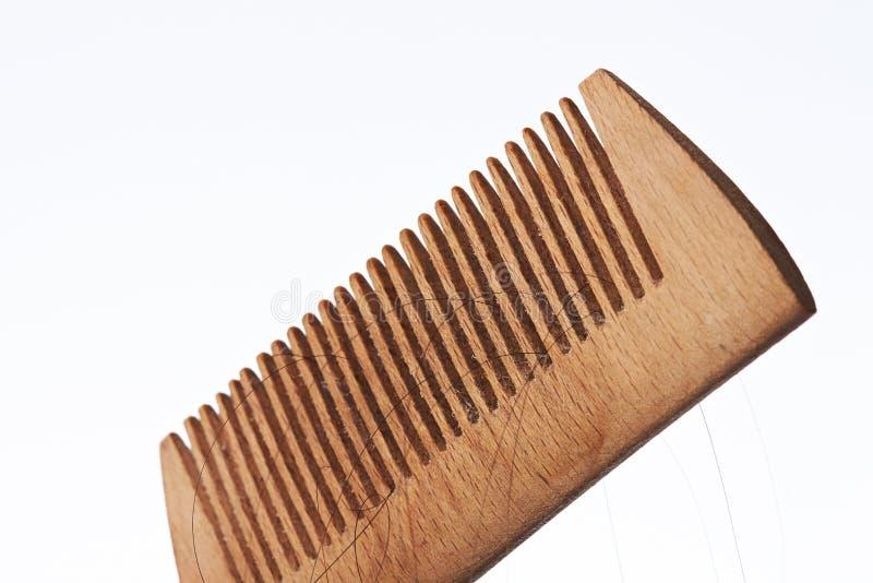 Przegrany włosy w drewnianej muśnięcie grępli obrazy stock