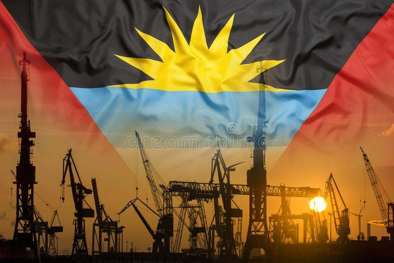 Przemysłowy pojęcie z Antigua Barbuda flaga przy zmierzchem zdjęcia royalty free