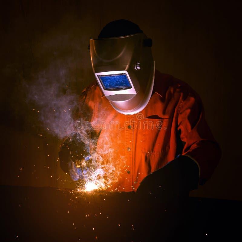 Przemysłowy pracownik z zbawczymi equipments i ochronną maską fotografia royalty free
