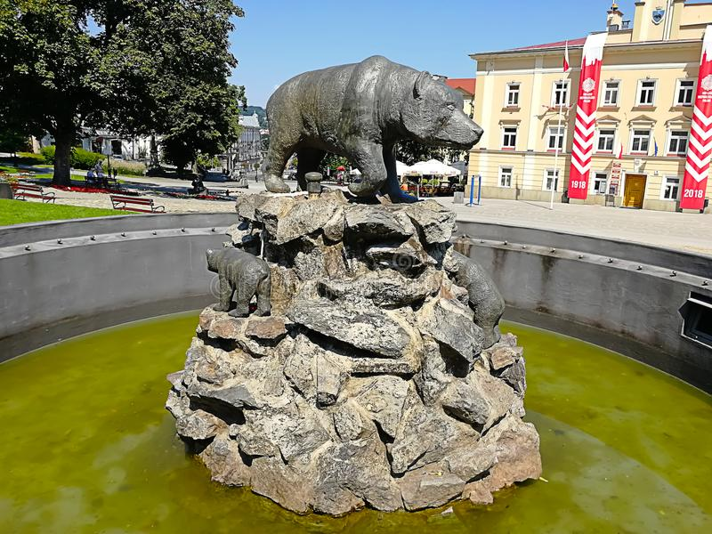 Przemysl, Poland - August 4, 2018: Fountain depicting a striding brown bear royalty free stock photo