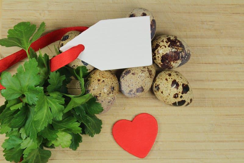 Przepiórek jajka, pietruszka i - fotografia stock