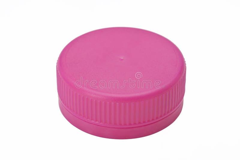 Przerzedże różową plastikową butelki nakrętkę odizolowywającą na białym tle obraz stock