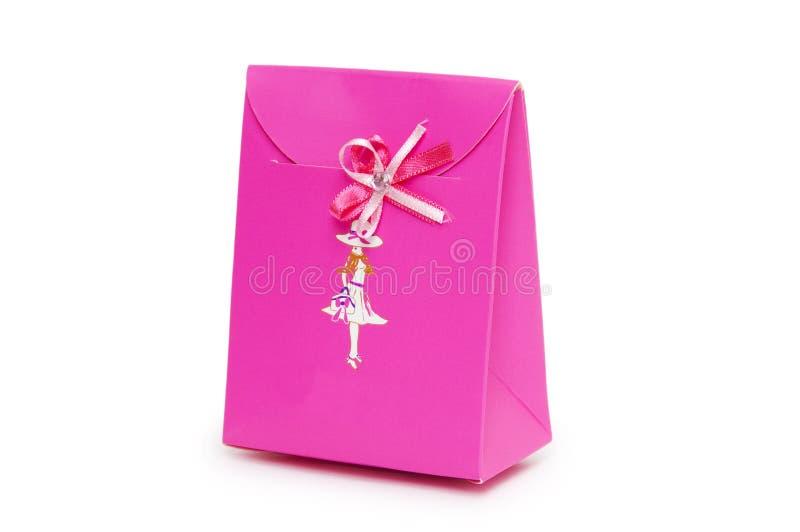 Przerzedże różowego prezenta pudełko na białym tle. obrazy stock