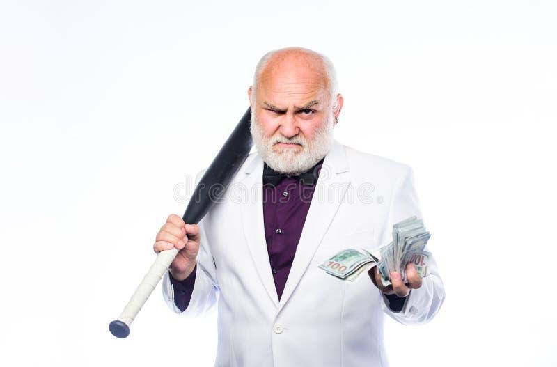 przest?pca i rabunek D?ug jama bogactwo dojrzały mężczyzna udziały pieniądze dojrzały brodaty mężczyzna z dolarowymi banknotami i fotografia stock