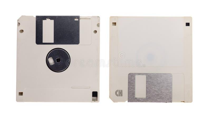 Przestarzała technologia - dwa używali opadających dyski odizolowywających na bielu fotografia stock